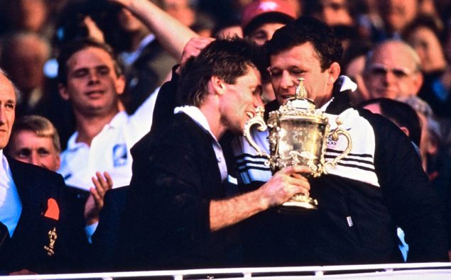 David Kirk with injured captain Andy Dalton and the Webb Ellis cup after the All Blacks won the 1987 Rugby World Cup final against France. (Photo / Photosport)