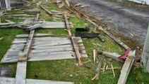 Boy racer crash destroys fence, leaves trail of destruction, car parts and clues