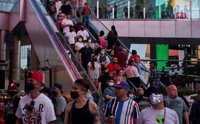 Las Vegas is bustling again after casino capacity limits were raised Saturday, May 1, to 80% and person-to-person distancing dropped to three feet. (Photo / AP)