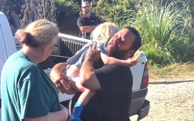 Father Glenn hugs son Axle after the three-year-old was found following an overnight search. Supplied / UAWA Live