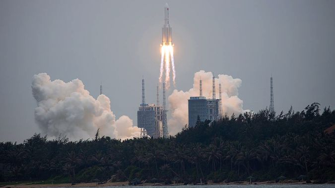 A Long March 5B rocket carrying a module for a Chinese space station lifts off from the Wenchang Spacecraft Launch Site in Wenchang in southern China's Hainan Province. (Chinatopix via AP)