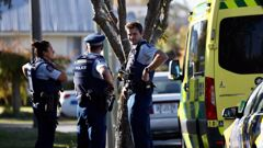 Armed police and emergency services are at the scene of an incident in Christchurch this afternoon. (Photo / George Heard)