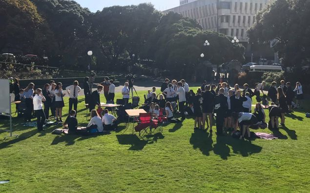 Students setting up at the protest. (Photo / Katie Harris)