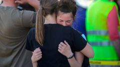 Students embrace after a school shooting at Rigby Middle School. (Photo / AP)