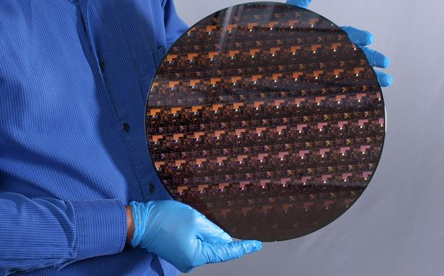 A wafer holding the new 2-nanometer chips developed by IBM. (Photo / CNN)