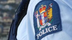 A Dunedin police officer was taken to hospital after boiling water was thrown at her face while on duty last night. (Photo / NZH)