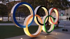 Illuminated Olympic rings are displayed before the new national stadium in Tokyo. (Photo / Photosport)