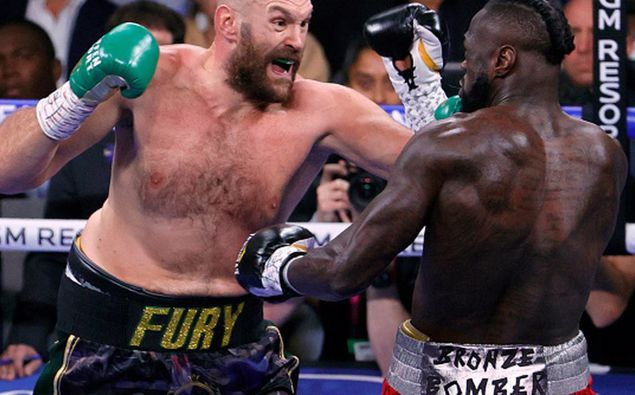 Tyson Fury and Deontay Wilder battle in the first round of their WBC heavyweight title fight. (Photo / Getty)
