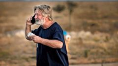 """Alec Baldwin speaks on the phone in the parking lot outside the Santa Fe County Sheriff's Office after he was questioned about a shooting on the set of the film """"Rust"""". (Photo / AP)"""