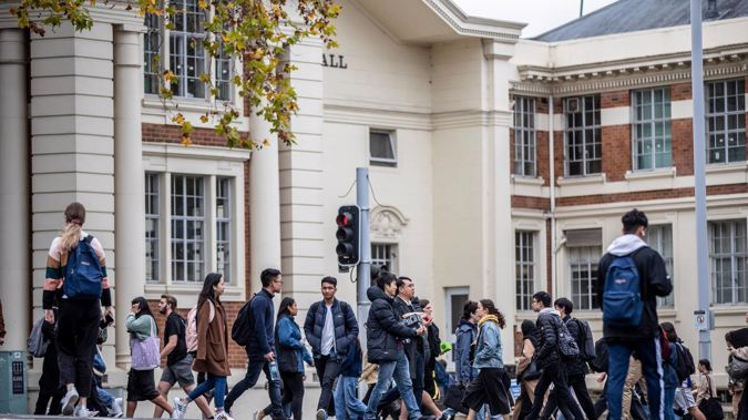 Auckland University students move between lectures on Symonds St. Photo / Michael Craig