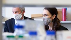 Prime Minister Jacinda Ardern tours Wellington's Malaghan Institute of Medical Research with director Professor Graham Le Gros. A Kiwi-made booster could be trialled by late 2022. (Photo / Getty Images)