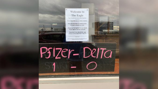A Bluff pub is in hot water for putting a sign up on their window that compares Ardern and Bloomfield to Hitler and Goebbels and Covid response to Nazi Jewish atrocities. (Photo / Marcus Lush / Twitter)