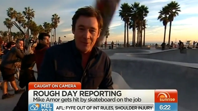 Reporter gets hit by skateboard