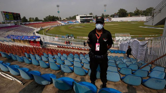 A Pakistani police officer stands guard an enclosure of the Pindi Cricket Stadium, where play between the Black Caps and Pakistan didn't begin due to a security threat. (Photo / AP)