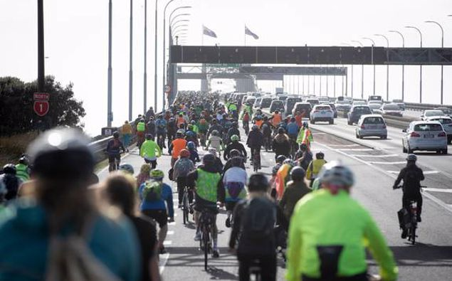 Cyclists cross the Auckland Harbour Bridge after calling for a three-month cycle lane trial. (Photo / Dean Purcell)