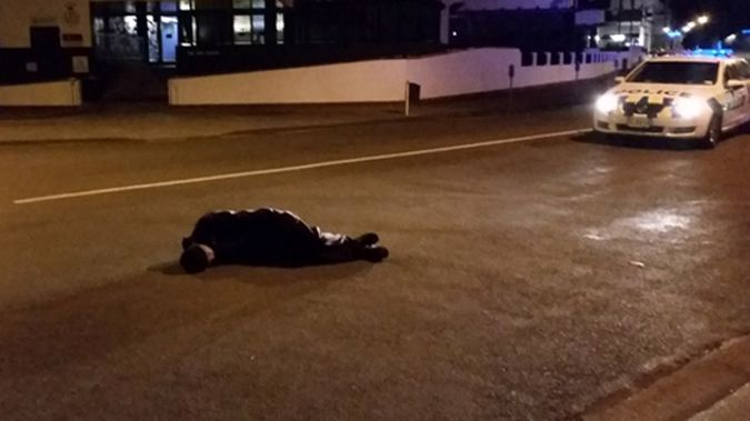 A drunk man who fell asleep on a Napier road (NZ Police)