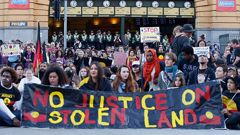 Demonstrators protest at the intersection of Swanston and Flinders street on April 10, 2015 in Melbourne, Australia (Getty Images)