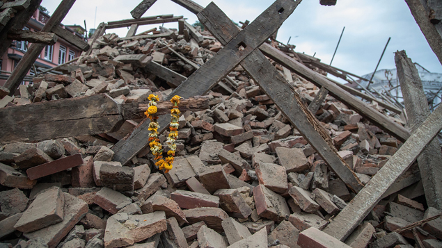 Flowers left on the debris of a destroyed building in Kathmandu (Getty Images)