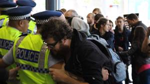 PHOTOS: Protesters and police face off at Sky City