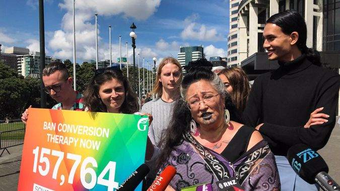 Green Party MPs Chloe Swarbrick, Marama Davidson and Elizabeth Kerekere deliver a 150,000-signature petition to Parliament calling for a ban on conversion therapy. (Photo / Sophie Trigger)
