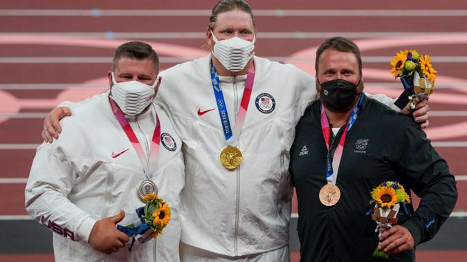 Joe Kovacs (L), Ryan Crouser (C) and Tom Walsh (R) celebrate their medals in Tokyo. Photo / Photosport