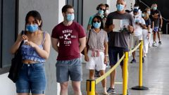 People wait in line at a Covid-19 testing station in Sydney's northern beaches on December 21 last year. (Photo / News Corp)