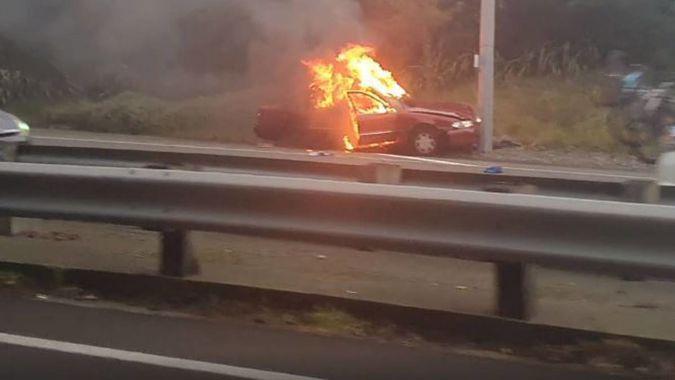 'Horrific and tragic': Hero stranger praised for dragging woman from fiery crash