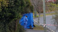 A forensic staff member at the scene on O'Donoghue St. (Photo / Mike Scott)