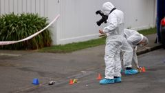Police forensic experts at the scene of the murder last month. (Photo / George Heard)
