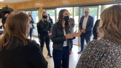 Prime Minister Jacinda Ardern chats with local health workers at a pop-up vaccination clinic at Eltham's Taumata Recreation Centre today. (Photo / Jamie Morton)