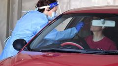 A health worker performs a COVID-19 test at a drive-through station in Brisbane on Thursday. There were more than 5,300 tests in Queensland on Thursday Picture: NCA NewsWire / Dan Peled