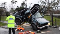 One dead, two injured after ute crashes into traffic light