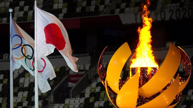 The Olympic flame is finally lit in Tokyo's National Stadium. (Photo / AP)