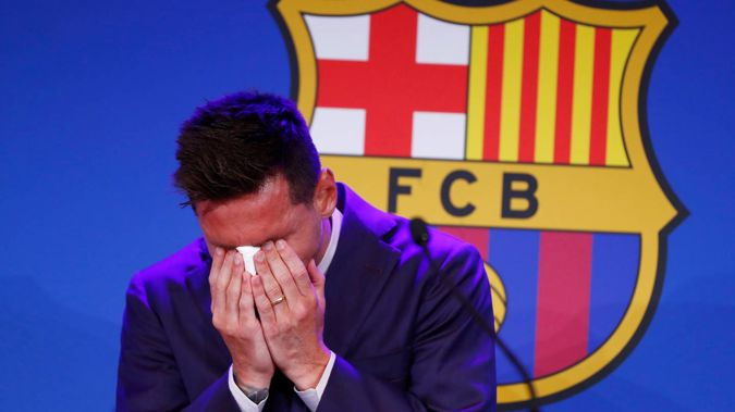 Lionel Messi cries at the start of a press conference at the Camp Nou stadium in Barcelona. (Photo / AP)