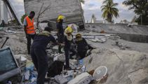 Haiti rescuers race to find survivors as storm threatens to follow quake