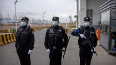 Police officers outside Urumqi No. 3 Detention Centre in Dabancheng, in western China's Xinjiang Uyghur Autonomous Region, on April 23, 2021. (Photo / AP)