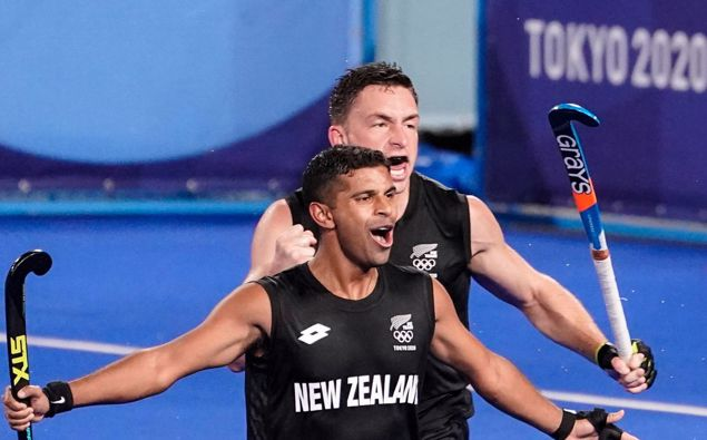 New Zealand's Jared Panchia reacts after Nick Wilson scores the go-ahead goal on Spain goalkeeper Francisco Cortes Juncosa during a men's field hockey match at the 2020 Tokyo Olympics. Photo / AP