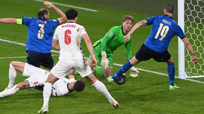 Italy's Leonardo Bonucci, right, scores his side's opening goal during the Euro 2020 final soccer match between Italy and England at Wembley stadium in London, Sunday, July 11, 2021. Photo / AP