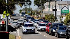 Parents queue to pick up their kids from St Thomas More College in Sunnybank, Brisbane. (Photo / NCA NewsWire)