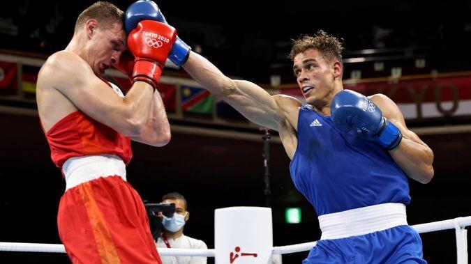 David Nyika lands a punch against Uladzislau Smiahlikau. Photo / Getty