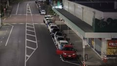 At 6.15am the queue for Henderson COVID testing centre already stretches to Railside Ave. (Photo / Michael Craig)