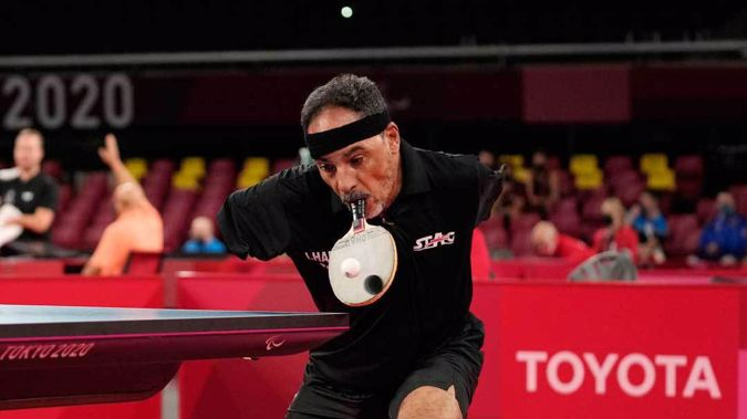 Ibrahim Hamadtou of Egypt plays against Park Hong-kyu of South Korea in Class 6, Group E of men's table tennis at the Tokyo 2020 Paralympic Games. (Photo / AP)