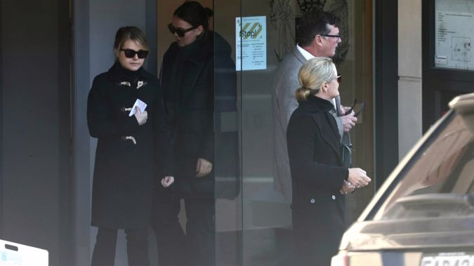Isabel Tully Robinson (left), 22, leaves the Queenstown District Court supported by family members. Photo / George Heard