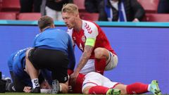 Denmark's Christian Eriksen lies on the ground after collapsing during the Euro 2020 soccer championship group B match between Denmark and Finland. Photo / AP