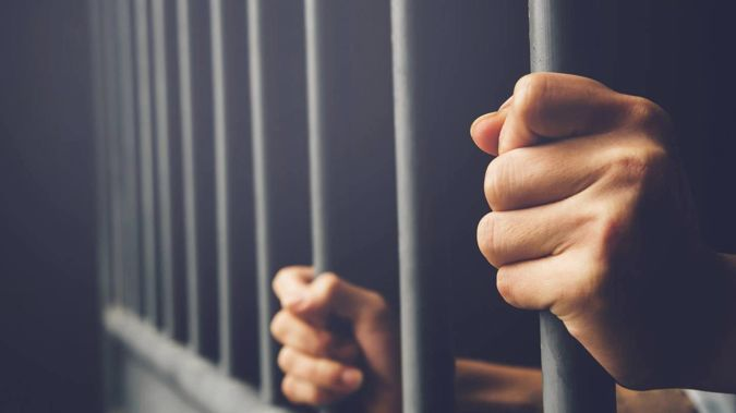 A number of offenders subject to deportation orders are living in the community after being released from prison because they cannot travel home due to Covid-19. (Photo / 123RF)