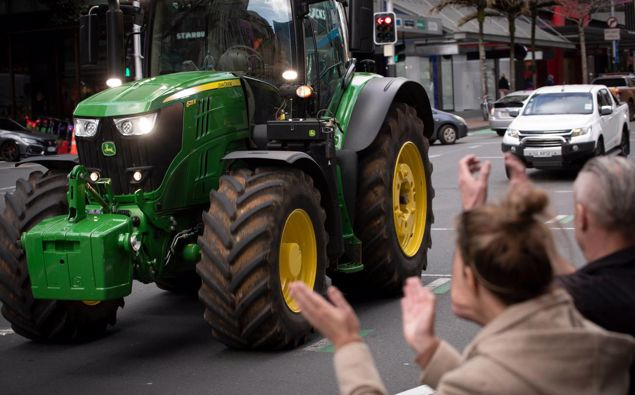 A John Deere tractor rumbles along Queen St in Auckland during the Howl of a Protest event, organised by Groundswell New Zealand. (Photo / Greg Bowker)