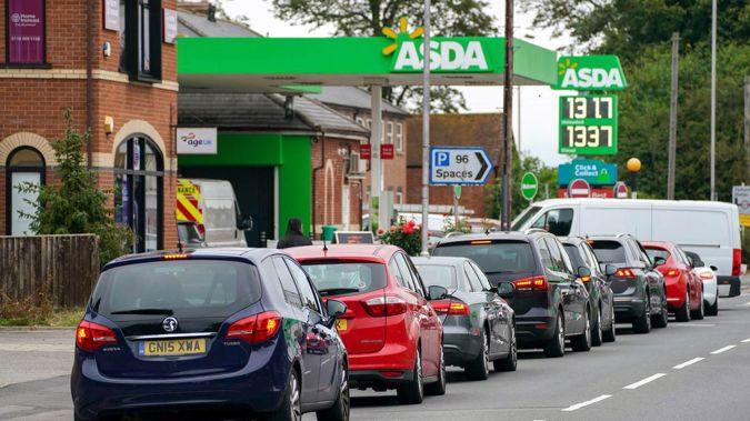 Cars queue outside a petrol station in Reading, England. (Photo / AP)