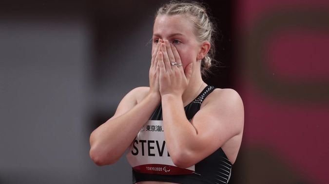 Anna Steven reacts after receiving a disqualification for a false start in the women's 100m T64 heats. (Photo / Getty)