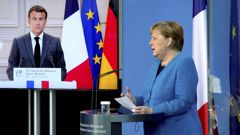 French President Emmanuel Macron is seen on a video screen during a joint press conference with German Chancellor Angela Merkel, right, as part of a virtual Plenary Session of the Franco-German Council of Ministers in Berlin, Germany. (Photo / AP)