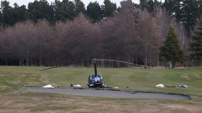 The helicopter crashed near a sand trap on the golf course at Terrace Downs Resort in Windwhistle, Canterbury. Photo / George Heard